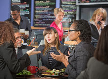 Mature Workers Talking in Cafe Stock Photography