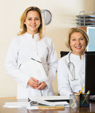 Mature and young female doctors in clinic Royalty Free Stock Photo