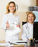 Mature and young female doctors in clinic Stock Image