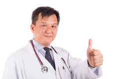 Matured Asian male medical doctor displays thumb up Stock Image