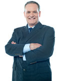 Matured businessperson posing with crossed arms Royalty Free Stock Image