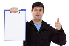 Matured male indicating down at whiteboard isolated over white. Background Royalty Free Stock Photo