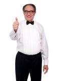 Matured man showing thumbs up Stock Photos