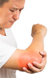 Matured man suffering from sore and painful elbow Royalty Free Stock Image