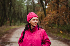 Matured woman in the forest Royalty Free Stock Images