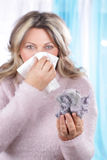 Matured woman with housedust and handkerchief Royalty Free Stock Photo