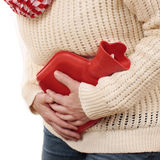 Matured woman with stomach pain and hot bottle Royalty Free Stock Image