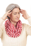 Matured woman with strong headache Stock Image