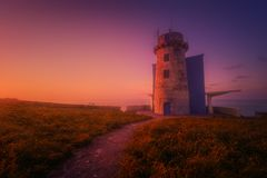 Matxitxako lighthouse in Bermeo. At the sunset royalty free stock photography