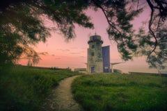 Matxitxako lighthouse. In Bermeo at sunset stock photos