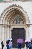 Matyas-templom or Matthias Church on Castle Hill in Buda Castle District, entrance door with tourists stock photo