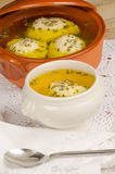 Matza ball soup on table Royalty Free Stock Photos