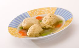 Matza Ball Soup on White. Bowl of matzah ball soup on white background Royalty Free Stock Photography