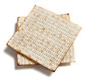 Matza bread on white. Two pieces of matza bread on a white background Royalty Free Stock Image