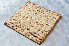 Matza for Jewish Holiday Passover. Traditional Jewish Matzo sheets on a Passover Seder table. Passover is a Jewish holiday festival. It commemorates the Exodus Stock Image