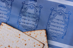 Matzah. Two pieces of matzah laying on a blue tallit representing Jewish symbols Royalty Free Stock Photography
