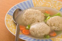 Matzah Ball Soup. Traditional Jewish chicken soup with matzah balls.  Often served for Passover Royalty Free Stock Images