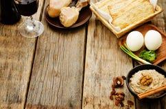 Matzah, wine, eggs, chicken, greens and haroset Stock Image
