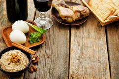 Matzah, wine, eggs, chicken, greens and haroset Stock Images