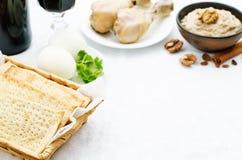 Matzah, wine, eggs, chicken, greens and haroset Stock Photos