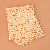 Matzo. On a paper background Royalty Free Stock Images