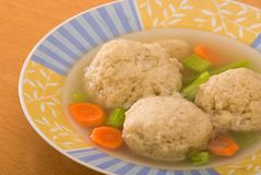 Matzo Ball Soup Macro. Close view of bowl of chicken soup with matzo balls; jewish staple at passover Stock Photo
