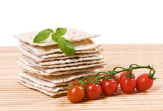 Matzo with tomato and basil Stock Photo