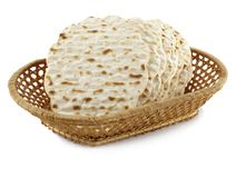 Matzoh. Jewish passover bread within pottle over white background stock photos