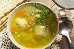 Matzoh Ball Soup. Delicious Matzoh ball soup with crackers wine and dill Stock Photo