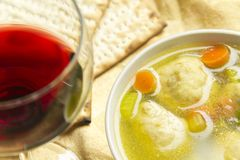 Matzoh Ball Soup. Delicious Matzoh ball soup with crackers wine and dill Stock Photography