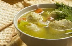 Matzoh Ball Soup. Delicious Matzoh ball soup with crackers wine and dill Royalty Free Stock Photography