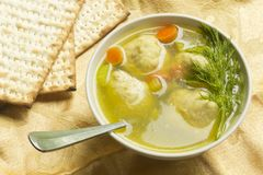 Matzoh Ball Soup. Delicious Matzoh ball soup with crackers wine and dill Royalty Free Stock Image