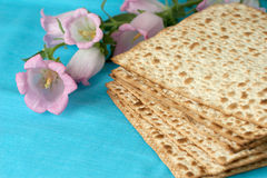 Matzos with flowers. On a blue fabrick Royalty Free Stock Photos