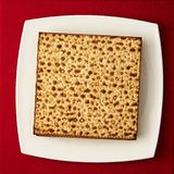 Matzos on the table. Matzos (jewish passover bread) on red table Stock Photo