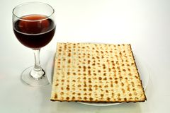 Matzos and wine. Matzos on a plate next to a glass of wine Royalty Free Stock Image