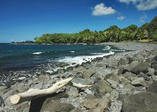 Maui Beach. A lava rock and cobblestone beach captured on a sunny afternoon on the eastern shore of Maui in Hawaii Stock Image