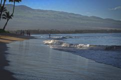 Maui beachwalkers. Waves lapping the shore at Kenolio Beach Park on Maui Stock Image