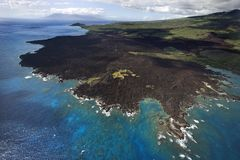 Maui coast with lava rocks. Royalty Free Stock Images