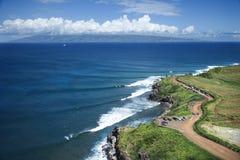 Maui coastline. Aerial view of coastline with surfers and parked cars on Maui, Hawaii Stock Photos