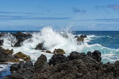 Maui. Coastline with blue skies, crashing surf and lava rocks Royalty Free Stock Photo