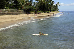 Maui Hawaii. Youngster learning to use surfboard at beach in  Maui, Hawaii Stock Images