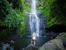 Free Maui, Hawaii Hana Highway, Sexy Blonde Girl Admires Wailua Falls In Road To Hana Stock Photo - 172332830
