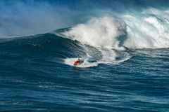MAUI, HAWAII, USA - DECEMBER 15, 2013: jetski driver brings a su Royalty Free Stock Photo