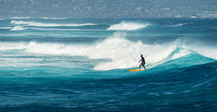 MAUI, HAWAII, USA - DECEMBER 10, 2013: Surfer is riding a wave a Stock Image