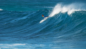 MAUI, HAWAII, USA - DECEMBER 10, 2013: Surfer is riding a wave a Royalty Free Stock Photo