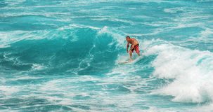 MAUI, HAWAII, USA - DECEMBER 10, 2013: Surfer is riding a wave a Royalty Free Stock Photos
