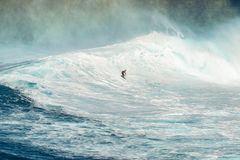 MAUI, HAWAII, USA - DECEMBER 15, 2013: Unknown surfer is riding. A big wave at Jaws Stock Photos