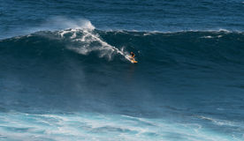 MAUI, HAWAII, USA - DECEMBER 15, 2013: Unknown surfer is riding Stock Photos