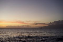 Maui Island Sun Set. Sun Set looking over the water to the next island and clouds in the sky Stock Images