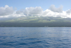 Maui with Molokini Crater. Molokini is popular for scuba diving and snorkeling Stock Image